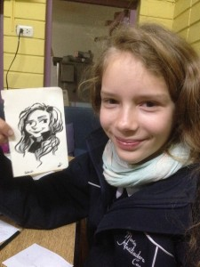 Dana, a relative of the owners poses with her sketch.