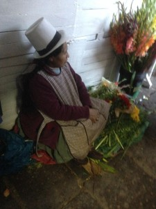 A woman peddles her flowers at the Mercado Central de San Pedro.